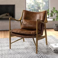 Inspired by Arts and Crafts design, the Harmony Accent Chair from the Eric Church Highway to Home Collection brings an eclectic twist to traditional décor. Sculptural curves, rich genuine leather, and the silky feel of well-loved wood come together in this stunning accent chair. With design cues taken from mid-century modern styles, it effortlessly blends vintage and modern aesthetics for a unique, noteworthy addition to decor themes ranging from rustic cabin to upscale modern office. Wooden…