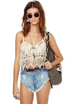 Nasty Gal Cream of the Crop Top: Its like we died and went to crop top heaven. Our newest boho look is made in a semi sheer crochet lace with scalloped edges, adjustable straps, and yes, a cropped silhouette. Its perfect with cutoffs, over a sexy slip dress, or with a ruffled maxi skirt. Unlined. Hand wash cold XXS $52.00