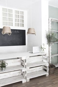 Painting the pallets white gives these shelves a less rustic, more chic appeal