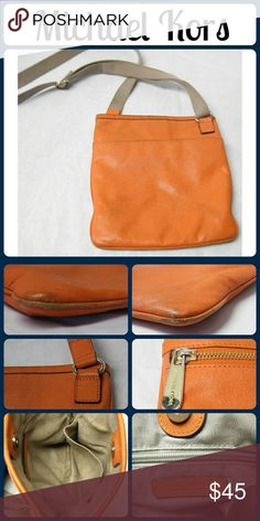 """Michael Kors  Leather Orange Cross Body Bag Interior has a zippered pocket and 2 open pockets. Exterior how a open open on each side and a zippered pocket on 1 side. The long crossbody strap is adjustable. The corners do have some rub wear but the rest of the bag is in great condition. Interior is perfect. No rips, tears or stains. From a smoke-free home. 9""""L x 10""""H x 1""""W Michael Kors Bags Crossbody Bags"""