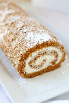 Classic Pumpkin Roll Cinnamon and cloves add the spice to this pumpkin sheet cake, topped with cream cheese frosting and rolled into a festive log. Pumpkin Cake Recipes, Fall Dessert Recipes, Pumpkin Dessert, Köstliche Desserts, Holiday Desserts, Fall Recipes, Sweet Recipes, Delicious Desserts, Pumpkin Log Recipe
