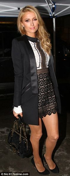 Two-tone style: Jet-setter Paris Hilton donned black and white ensembles after flying home...