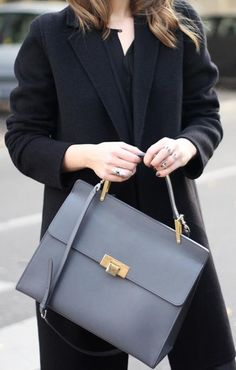 A sloppy bag may reflect a sloppy person. Not what you're going for? No worries! This season, gravitate toward structured bags. The clean lines and distinct shapes imply organization and professionalism.
