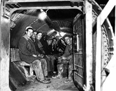 Sandhogs, constructing subway tunnel under East River, sit in a decompression chamber.