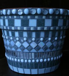 Mosaic flower pot in shades of grey, white and silver. $65.00, via Etsy.