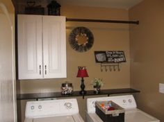 Love the little shelf added above the washer and dryer!