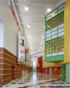 Dubose Architecture used bright colors from our #Pearlescence collection to set the tone at The Sport and Medical Sciences Academy, making the design of the building as unique as its mission. #interiordesign #education #commercial #laminart #veneer #laminate