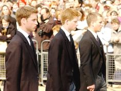 Prince William (L) Prince Harry (C) and Peter Phillips walk behind the coffin bearing the Queen Mother April 5, 2002 as her ceremonial procession makes its way down the Mall in London.