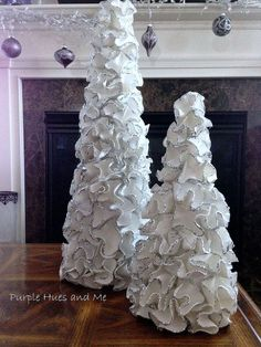 Ruffled Foam Sheets & Glitter Christmas Tree Cones DIY - Yet another way to decorate a cone tree using foam sheets and glitter:  This is totally a diy craft starting with making the cone out of poster board, cutting out circles of foam sheets, turning the circles into ruffles using an iron, sprinkling the glue coated edges with glitter and finally gluing the ruffles on the cone tree with hot glue. That's all it takes to make this easy and elegantly looking tree.