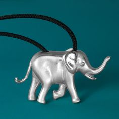 Unique solid sterling silver elephant necklace pendant, in matte finishing with glossy details to highlight the design. A micro-sculpture in a jewel! This jewelry have a wonderful detailing and flawless 3D craftsmanship with my unique repousse technique. #elephantjewelry #elephantpendant #elephantnecklace #elephantcharm #silverelephant