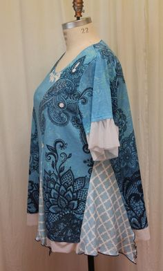 Romantic Womens loose fit tunic Up-cycled Plus size tunic summer blouse bohemian women top Altered clothes Fairy wear reconstructed ladies t shirt up-cycled clothing 2X-3X  This beautiful tunic blouse is made from printed tee shirts and lace, scoop neck, front embellished with nice lace motif, short sleeves, loose fit, ,fit sizes 20-22-24, finished hem, cotton acrylic mix, comfortable and unique summer tunic, measurement : bust- 54 in flat waist - 58 hip - 80+ length: back from shoulder - 34…