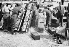 British armourers preparing fire-bombs (of 4-lb incendiaries Magnesium) at RAF Marham, Norfolk. Incendiaries were carried in an aircrafts bomb bay using Small Bomb Containers (SBC's) and were packed into cluster's. [Photo © IWM (CH 10710).]