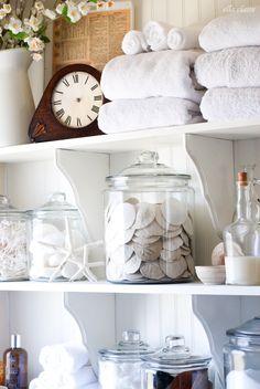 Lovely DIY Bathroom Linen Shelves