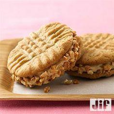 Jumbo Honey-Roasted Peanut Butter Sandwich Cookies - Cream-filled sandwich cookies are a peanut butter lover's dream come true. Cookie Desserts, Just Desserts, Cookie Recipes, Dessert Recipes, Dessert Bars, Yummy Treats, Sweet Treats, Yummy Food, Yummy Cookies