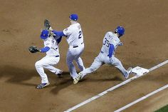 The Royals EricHosmer, right reaches first base on fielder's choice as Mets pitcher Noah Syndergaard, left, and Lucas Duda can't get him out. , Zobrist scored, Cain out at second. The NY Mets host the Kansas City Royals in game 3 of the 2015 World Series at Citi Field. Friday October 30, 2015. Flushing, NY,USA (Aristide Economopoulos | NJ Advance Media