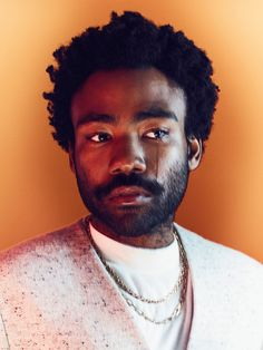 Coat by Cos; shirt by Topman Stores; chain by Cartier; tear by Donald Glover