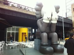 kaws-scultpure-giant-crying-standard-hotel-new-york-city-meat-packing
