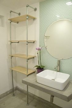 shelf in the bathroom from the pipes with your hands