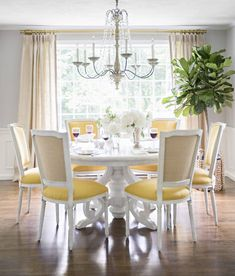 sunny yellow dining chairs make this formal dining room more casual and bright DominoMagazineBestDesignBlogs - Design Chic