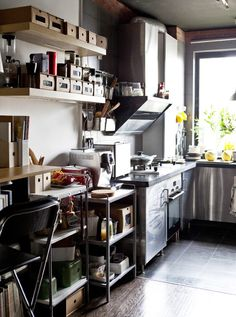 Make kitchen more open- maybe remove some of the cabinet doors - hang the knives on magnet strip to clear up counter space