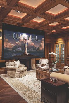 I love that this room looks all sophisticated and then... oh yeah we just have a giant screen hidden in the ceiling for movie nights.