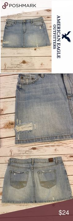 "American Eagle Distressed Denim Skirt Cute distressed denim skirt in light denim wash by American eagle. Worn a few times. No stains, rips or marks. Length 13"". American Eagle Outfitters Skirts Mini"