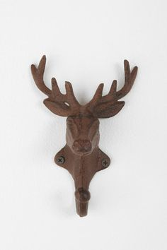 Spray paint these a bright color and hang a few in a row for a cool Christmas coat rack!  (Antler Hook from Urban Outfitters $12.99 ea))