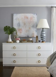 I absolutely adore this IKEA malm dresser design hack by Erin Gates. The malm dresser from IKEA ($150) is the best dresser I've ever bought as far as functionality. I think I may have to reintroduce it back to my master BR in white with some great hardware like brass or leather pulls. LOVE it.