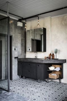 Another interesting take on the industrial styled interior with patterned tile work. Fabulous muted colours.