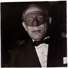 Masked man at a ball, 1967 © Diane Arbus