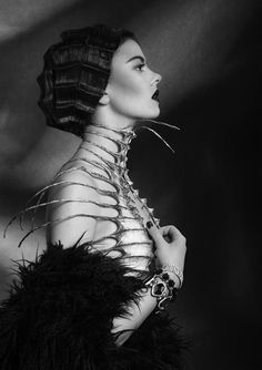 FASHION OBSESSION: Nika Danielska Design  Nika Danielska is a stylist and sculptor who brings fetish and biomorphic concepts to the forefront of her dramatic, macabre style.  Sharp and daring in design, her heavily-infused-with-fetish designs feature masks, neck braces, shoulder spikes and constricting skeletal cages.