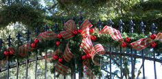 Gate decorated for the holidays with deco mesh and tinsel tie balls