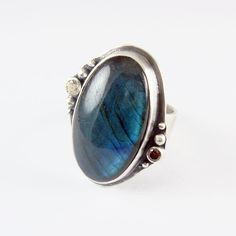 0000628_labradorite_ring_in_sterling_silver_and_cubic_zirconia.jpeg 900×900 pixels