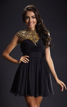 A beautiful black prom dress with gold embellishments around the neckline. Sexy and elegance combined with flared skirt and exposed back. Gold beading brings a touch of sophisticated glitziness. Overall quite striking and a dress you will feel exquisite in.