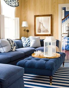 Long Island sofa in Brancaster Navy   Aldwych coffee table   This room feels almost nautical with the deep blue furniture and the blonde  wood walls. Blue Furniture Living Room. Home Design Ideas