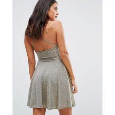 Wal G Halterneck Skater Dress ($27) ❤ liked on Polyvore featuring dresses, gold, halter neck skater dress, flared skirts, circle skirt, halter top and jersey dresses