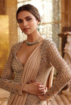 Deepika Padukone is seen here during a photoshoot for a leading jewellery brand. The pretty actress donned a desi avatar and even posed with gorgeous...