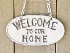 """Cast Iron Distressed White """"Welcome to our Home"""" Sign with metal chain by TrueNorthHome on Etsy https://www.etsy.com/listing/490290109/cast-iron-distressed-white-welcome-to"""