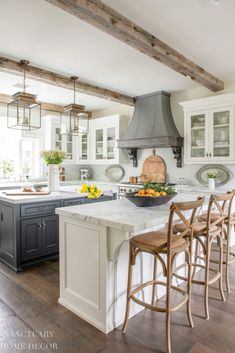White kitchen with glass cabinets and dark center island- farmhouse kitchen-cottage kitchen-french country kitchen-Summer decorating