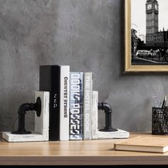 A bookend that is an decorative accent: With a unique blend of rustic and industrial style, these metal pipe and whitewashed wood bookends are a piece of art themselves! Industrial Bookends, Wood Bookends, Industrial Pipe, Industrial Style, Industrial Design, File Folder Organization, Wall Trellis, Metal Pipe, Whitewash Wood