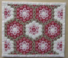 Beautiful use of hexagons. From Sew many yarns: English Paper Piecing Patchwork http://sewmanyyarns.blogspot.com.au