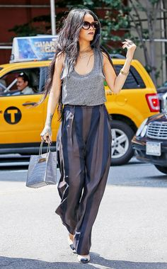 Rihanna kills it in a T by Alexander Wang tank and vertically striped trousers. // #Celebrity