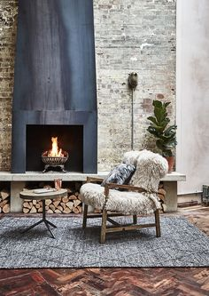 Create a cosy fireside seating area with our Timothy Oulton Yeti Chair.