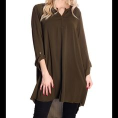 NWT chic tunic top! Subtle V-neck 3/4 sleeve tunic that can be paired with leggings or skinny jeans. Excellently fabricated olive v-neck blouse is equipped with buttoned sleeves and trendy tunic length. Olive Green. Tops Tunics
