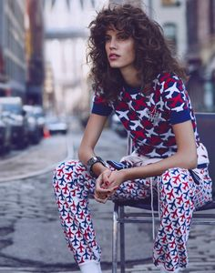 Sitting down, Antonina models a Chanel sweater and trousers with a plane print for Vogue Mexico Magazine March 2016 issue