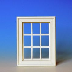 Lattice windows, white (50281) made of natural wood, 9-piece, with genuine glass pane, like #50280, but painted in white. Dimensions: 88 x 111 mm, cut-out dimensions: 73 x 97 mm.