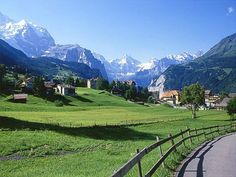 interlaken, switzerland - I know exactly where this is! Walked this same road... who could forget that view of the mountains!