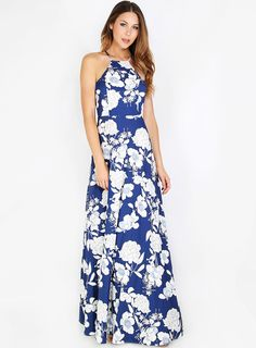 """Get your floral fix with the Floral Halter Maxi Dress! Features a halter neckline, back zipper, button closure, and an all over floral pattern. Dress measures 59"""" approx. Pair with soft makeup and waves!"""