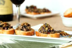 olive-tapenade-with-pepitas-on-garlic-toast