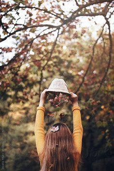 Autumn leaves falling from girl's hat by Jovana Rikalo